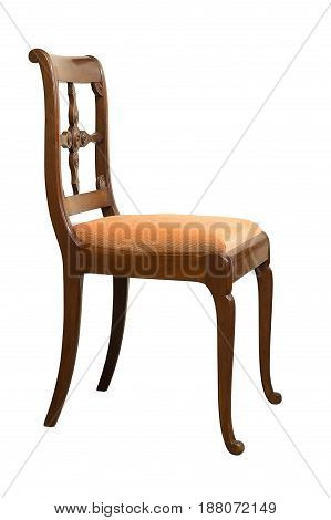 Antique Biedermeier chair isolated with orange fabric and wood carving