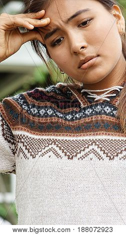 Confused Beautiful Girl Wearing a Knit Sweater