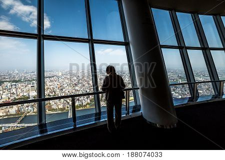 Tokyo, Japan - April 19, 2017: tourist at Tembo Deck observation deck. The Tokyo Skytree is a television broadcasting tower and landmark of Tokyo. Concept of travel and asian metropolis.