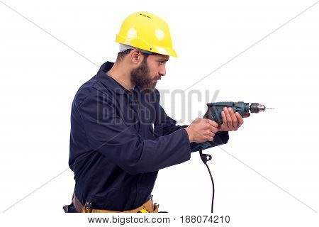 Smiling beard young worker drilling by driller tool and looking side man wearing workswear isolated on white background