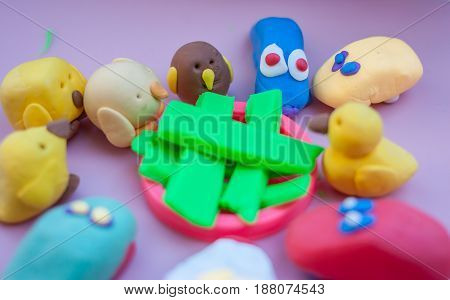 toys made of plasticine standing together developing game for children