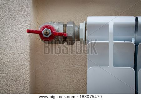 valve on the radiator closeup. abstract interior photo