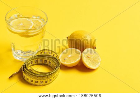 Centimeter, Lemon With Freshly Squeezed Glass Of Citrus On Yellow