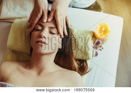 Young beautiful and healthy woman in spa salon. Traditional oriental massage therapy and beauty treatments.