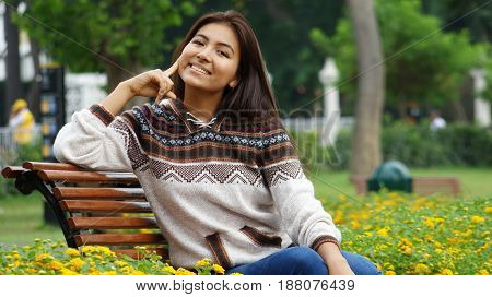 Minority Girl Sitting in a Public Park