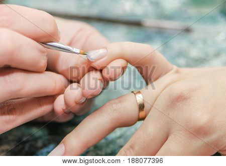 The process of performing a manicure closeup