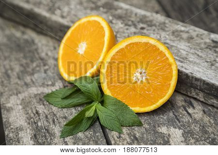 Fresh oranges slice decorated with mint leaves.