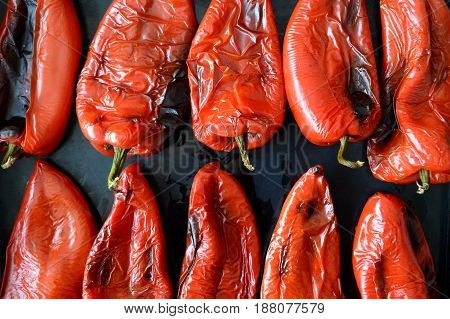 Top view of roasted red pepper on black background