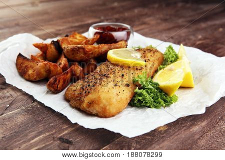 traditional British fish and chips on brown background