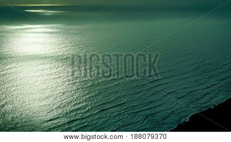 aerial view of rippling water and shoreline