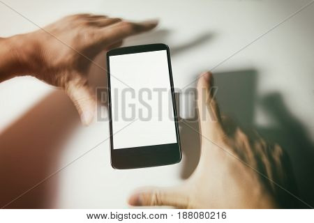 cellphone and blur hands with blank screen. communication concept.