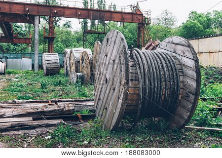 Industrial landscape, wood material rusty steel cable Coils or iron wire