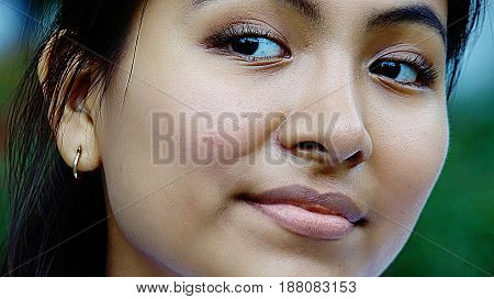 A Close Up Face Of Minority Person