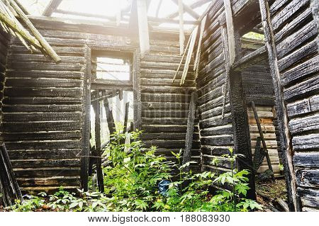 Inside interior of old abandoned wooden burned out mansion building, house without roof