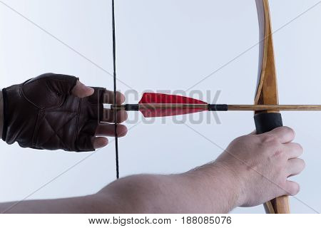 Two Arms Archer Wearing Open Fingers Leather Gloves Drawing A Traditional English Longbow With A Red