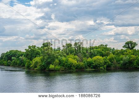 Natural background lake or river forest and sky with clouds on the whole frame