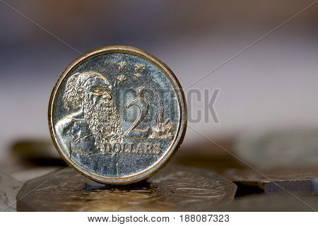 Australian two dollar coin depicting and aboriginal man from the first nation.
