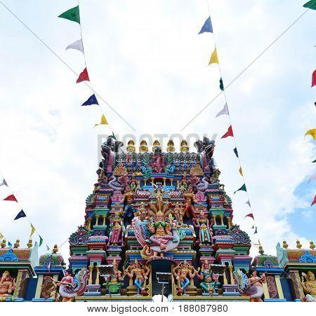 Hindu god statue on the facade of Hindu temple Penang Malaysia