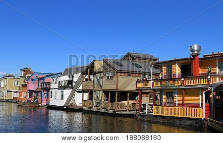 VICTORIA CANADA - May 29 2016: Victoria Inner Harbour, Fisherman Wharf.  Residential area with floating homes, boats, piers, shops, and restaurants.