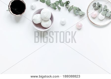 sweet marsh-mallow and spring flowers on woman white desk background top view mock up