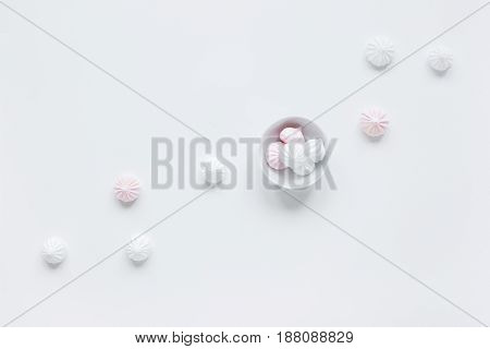 sweet lunch with marsh-mallow for woman on white table background top view