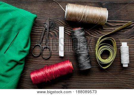 Sewing tools and kit for handmade hobby collection on wooden background top view