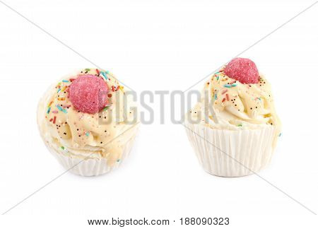 Cupcake shaped bath salt bomb isolated over the white background, set of two different foreshortenings