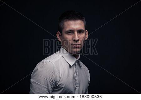 One Young Man, Sideways Head Face Headshot, Black Background