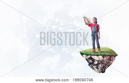 Cute girl on floating island with paper plane in hand presenting social connection concept