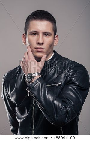 Young Man, Blank Expression, Leather Jacket, Hand Touching Face