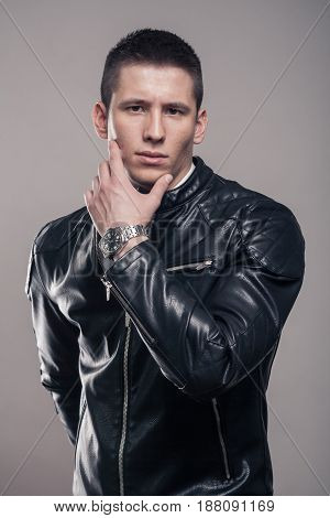 Young Man, Hand Touching Face, Leather Jacket, Intense Look