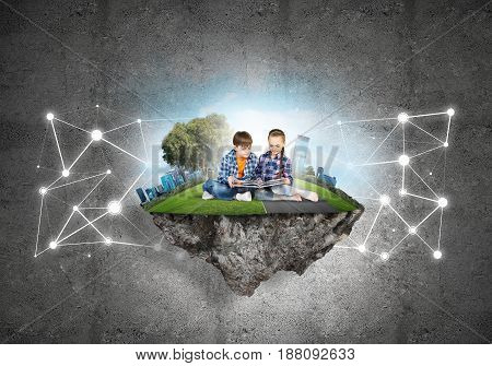 ECO concept floating island and children with book sitting on it