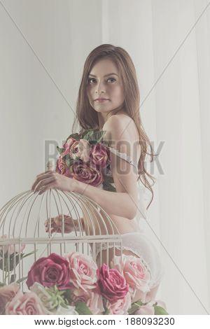 Lovely girl in lingerie flirting. Bra of flowers. Spring mood. Soft focus.