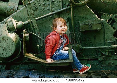 Portrait of a little girl in jeans