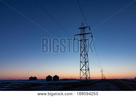 Horizontal format of Transmission Tower Silhouetted at Sunset