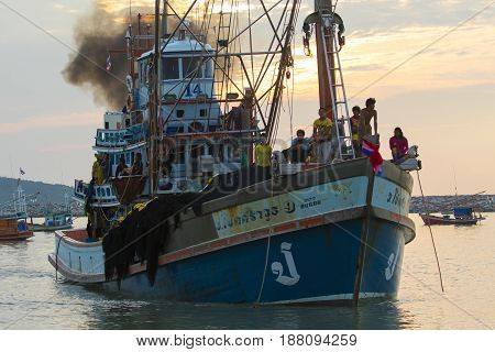 PRACHUAP KHIRI KHAN THAILAND - MARCH 29 2017 : thai fishery boat approaching to klong wan port on early morning with fresh fish after over night seeking prachuap khiri khan is the longest coastal province in thailand