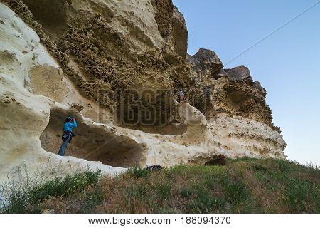 Tourists on the walls of Cave city Bakla in Bakhchysarai Raion, Crimea.