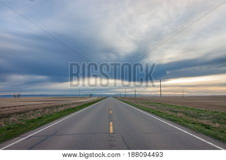 Wide open two lane country highway in the prairies