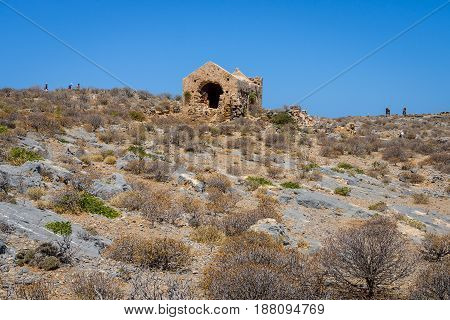 The ruins of a Christian church in the territory of the ancient Venetian fortress on the island Imeri Gramvousa. Mediterranean Sea. Crete. Greece.