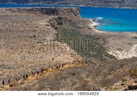The descent of tourists from the ancient Venetian fortress. Natural landscape of the island Imeri Gramvousa. Mediterranean Sea. Crete. Greece.
