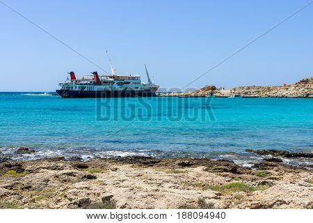 View on the bay of island Imeri Gramvousa Mediterranean Sea. In the background a cruise ship. Crete. Greece.
