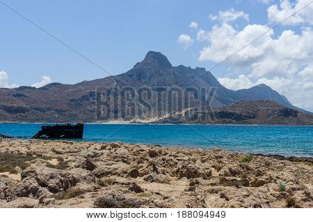 View on the bay of island Imeri Gramvousa and Mediterranean Sea. In the background the mountains and hills of the west coast of Crete. Greece.