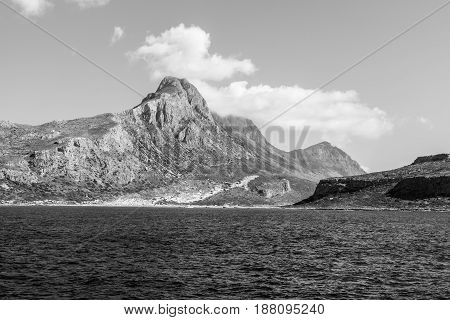 Seascape. View from the sea on the west coast of Crete. Greece. Black and white.