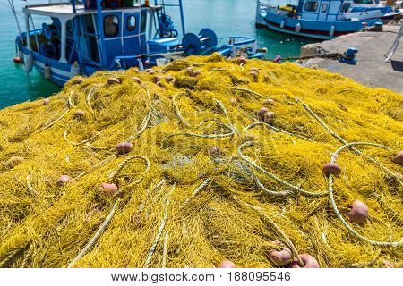 The fishing nets on the quayside of seaport.