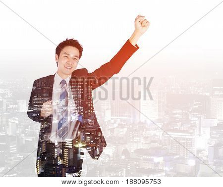 Double Exposure Of Success Businessman Keeping Arms Raised With City Background