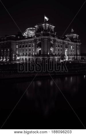 Reichstag building in the night illumination. Reichstag building - is German parliament (Bundestag). Black and white. Germany