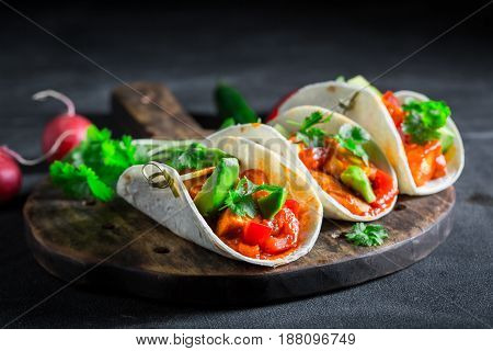 Spicy Tacos With Spicy Sauce And Fresh Coriander