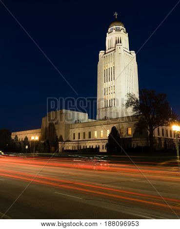 Cars Sreak By at Night in front of Lincoln Nebraska State Capital Building