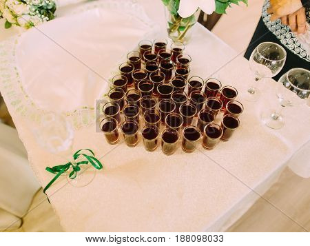 Above view of the glasses with whiskey in the form of the heart