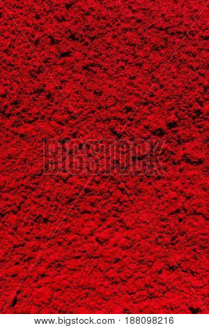 Textured red wall background rough concrete decoration. Colorful vertical architecture for your text.
